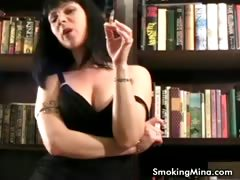 Brunette babe smoking while posing sexy